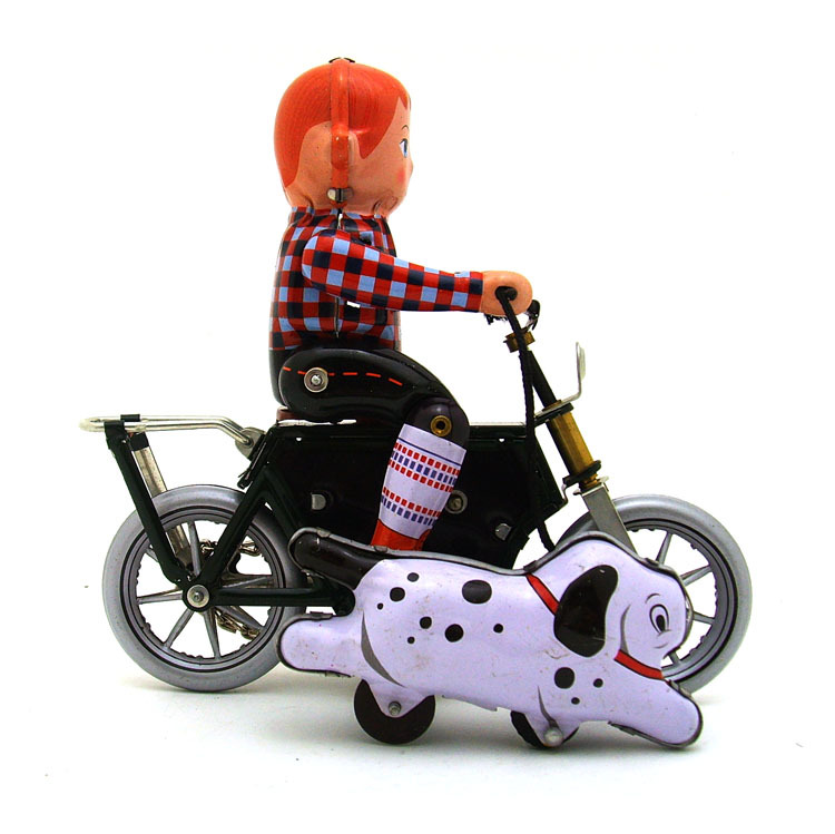 וינטג ילד על אופניים עשוי פח בעבודת יד - צעצועים של פעם