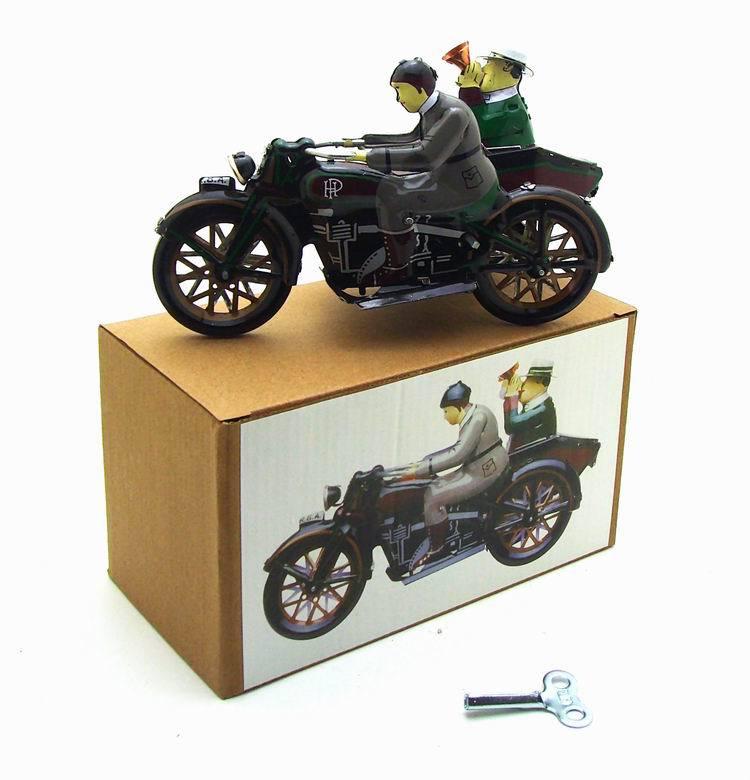 שני אנשים באופנוע עשויים מפח - צעצעוי רטרו