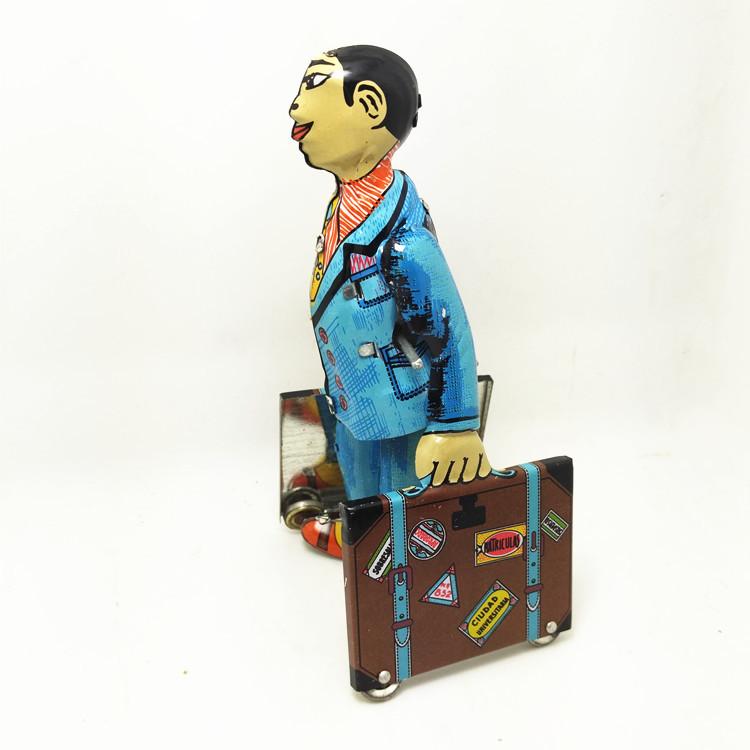 איש עם מזוודה מוצר רטרו מפח